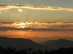 Sunset near Lake Danum, sun obscured by cloud layers